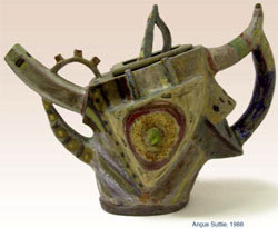 12. Stoneware Teapot, hand-built with painted decoration under a transparent matt glaze. 1990, H.27 cm
