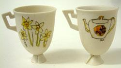 20. Porcelain cup on base with Welsh tea party illustration.2003, H. 7.5cm