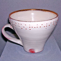 Braille cup. Earthenware with slip decoration and gold, 2005 10 cm high