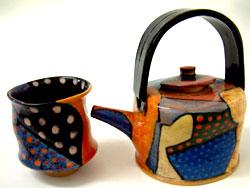 17. Earthenware teapot with coloured slips, 1992, H. 18cm; Mug. H. 10cm