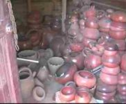 Munchie's storage shed showing many pots which she has made