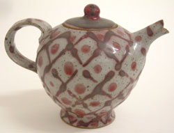 7. Stoneware teapot with pink painted decoration, 1979, H. 12 cm